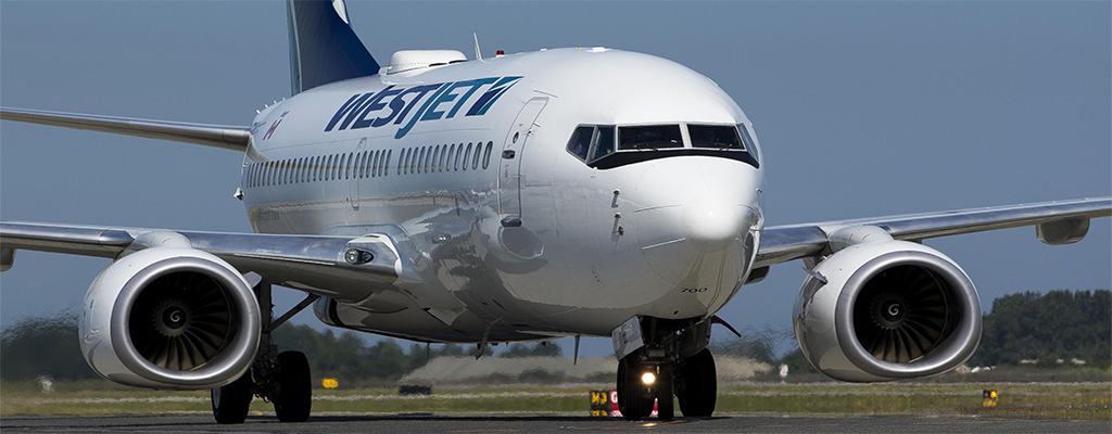 46439ed118 Air Canada And WestJet Announce Increased Fees For Passengers To Check  Luggage